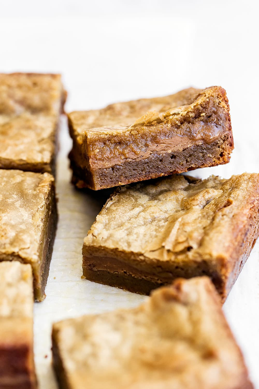 Cookie Butter Stuffed Blondies features a butterscotch brownie filled with gooey fudgy Biscoff cookie butter filling for the ultimate sweet treat!