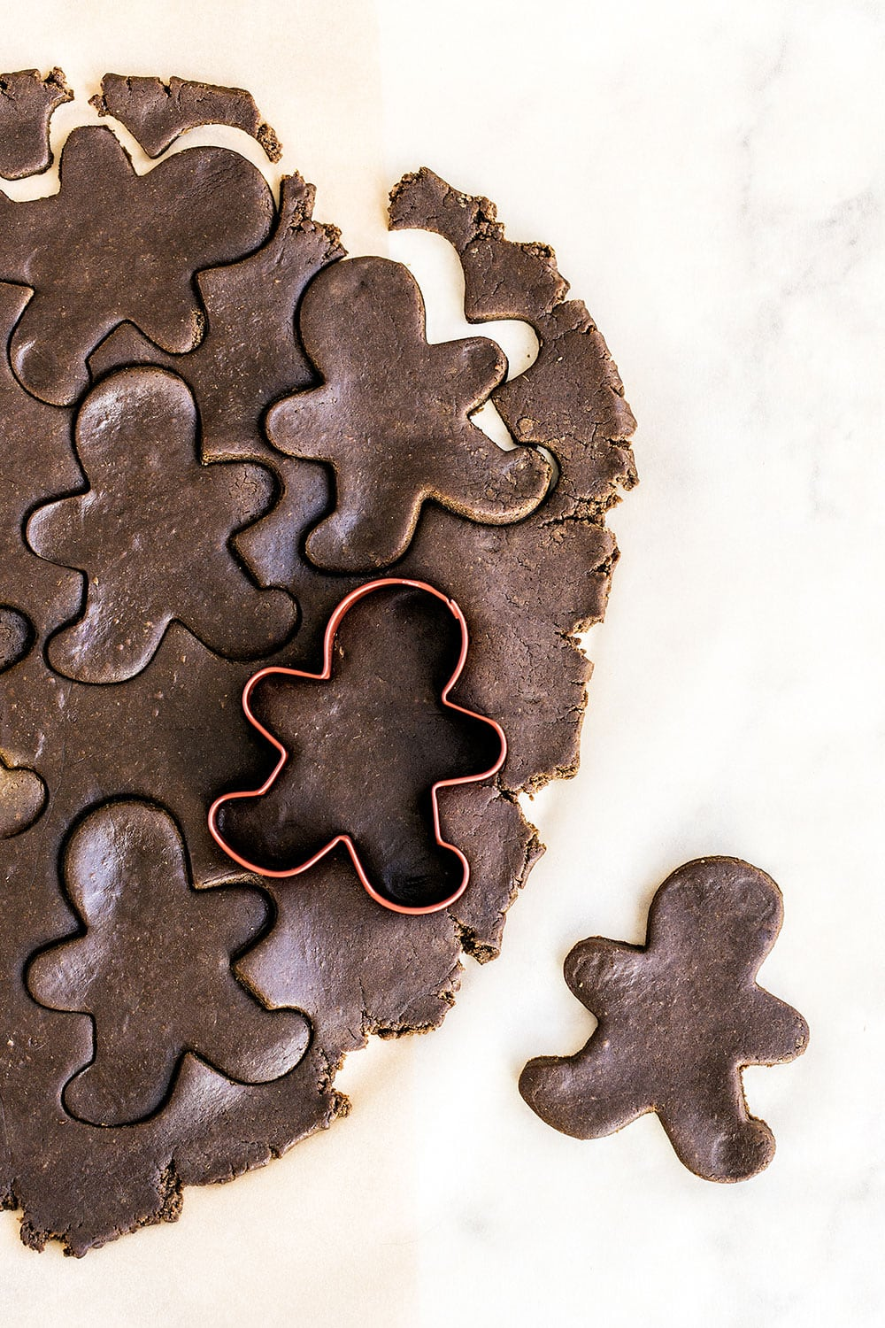 This gingerbread cookie dough is so easy to work with and the cookies actually keep their shape while baking!