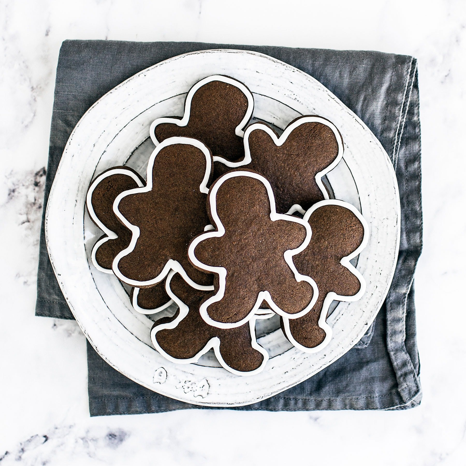 Easy Gingerbread Cookies are thick, soft, and perfectly maintain their adorable shape. This dough is a dream to work with and the cookies can be made ahead of time! Easy cookie icing included.