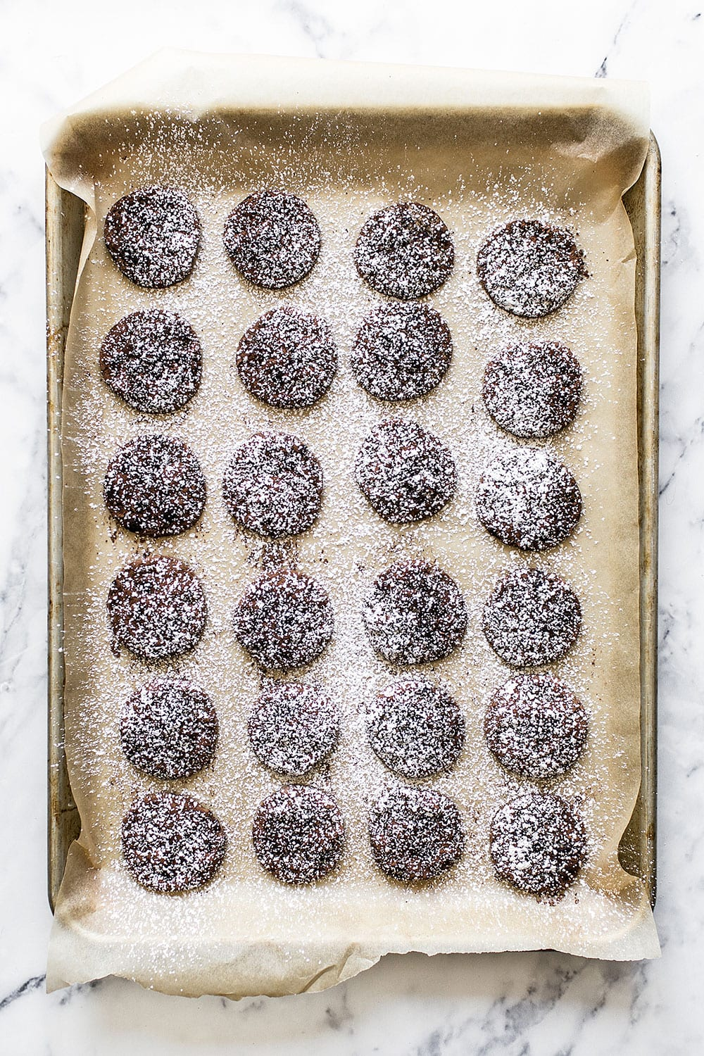 Mocha Cookies are bite-sized soft and chewy espresso chocolate chip cookies coated in cocoa powder and dusted with a snowfall of powdered sugar. A great Christmas cookie recipe!