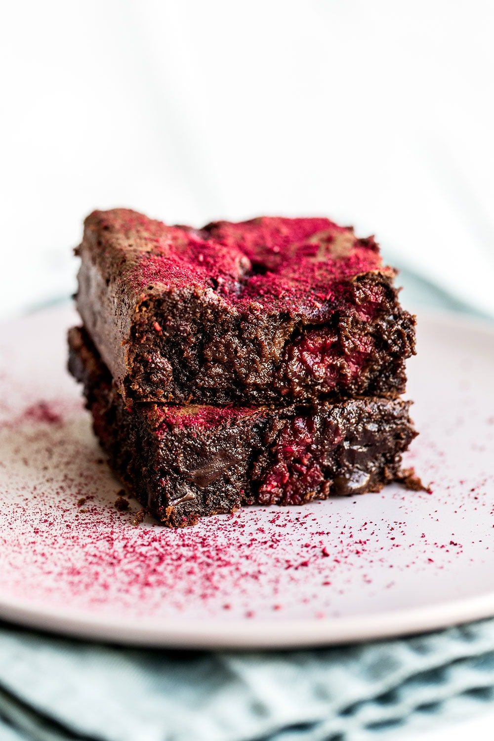 These raspberry brownies are ultra tall and chewy and are perfect for Valentine's Day!