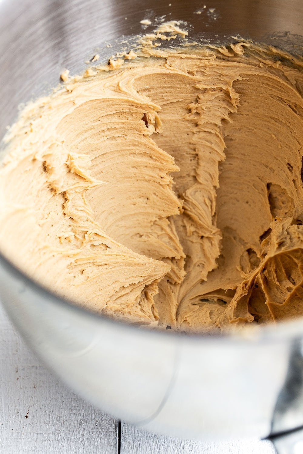 Mixing bowl filled with peanut butter buttercream