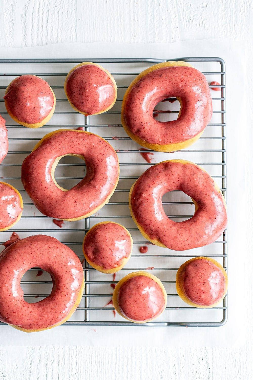Freshly glazed doughnuts on a rack