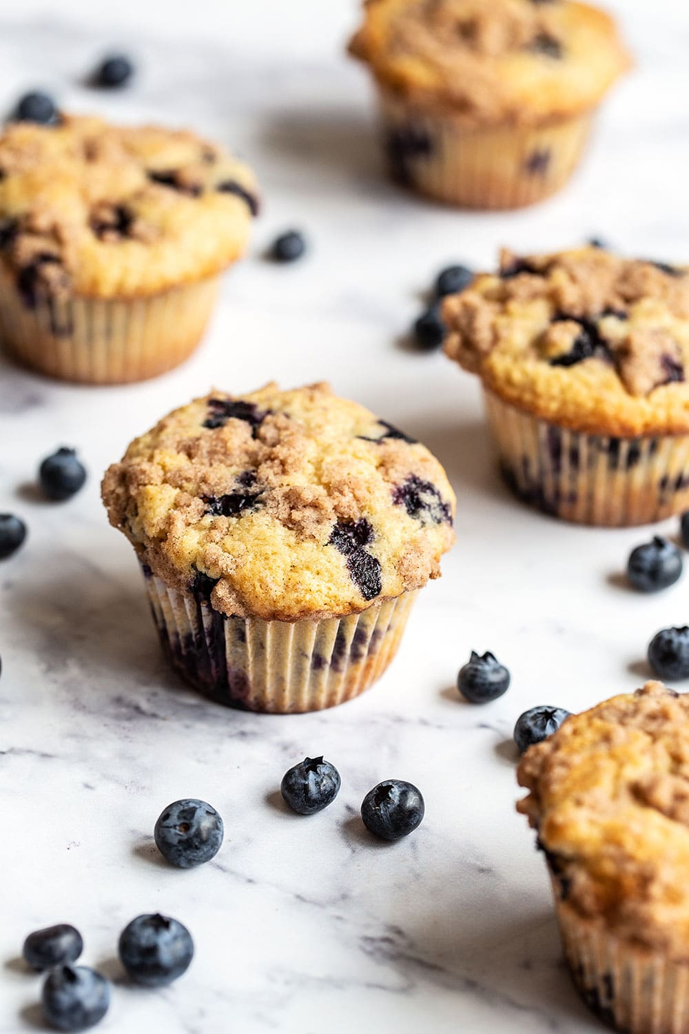 Fresh blueberry muffins on a marble counter