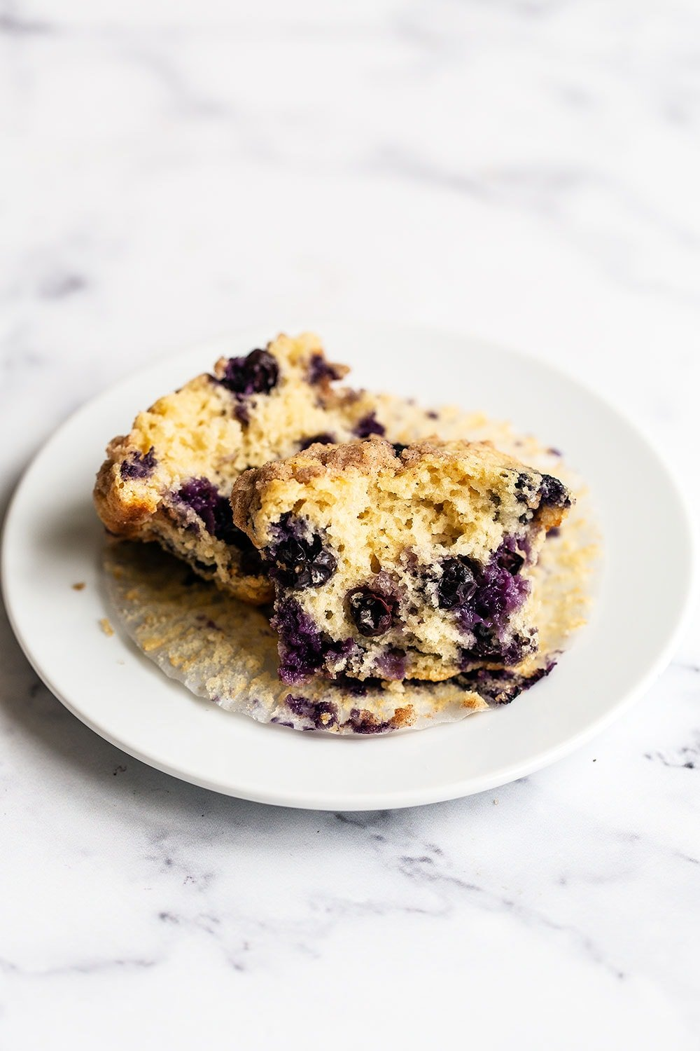 Tender and fluffy brown butter blueberry muffin cut in half
