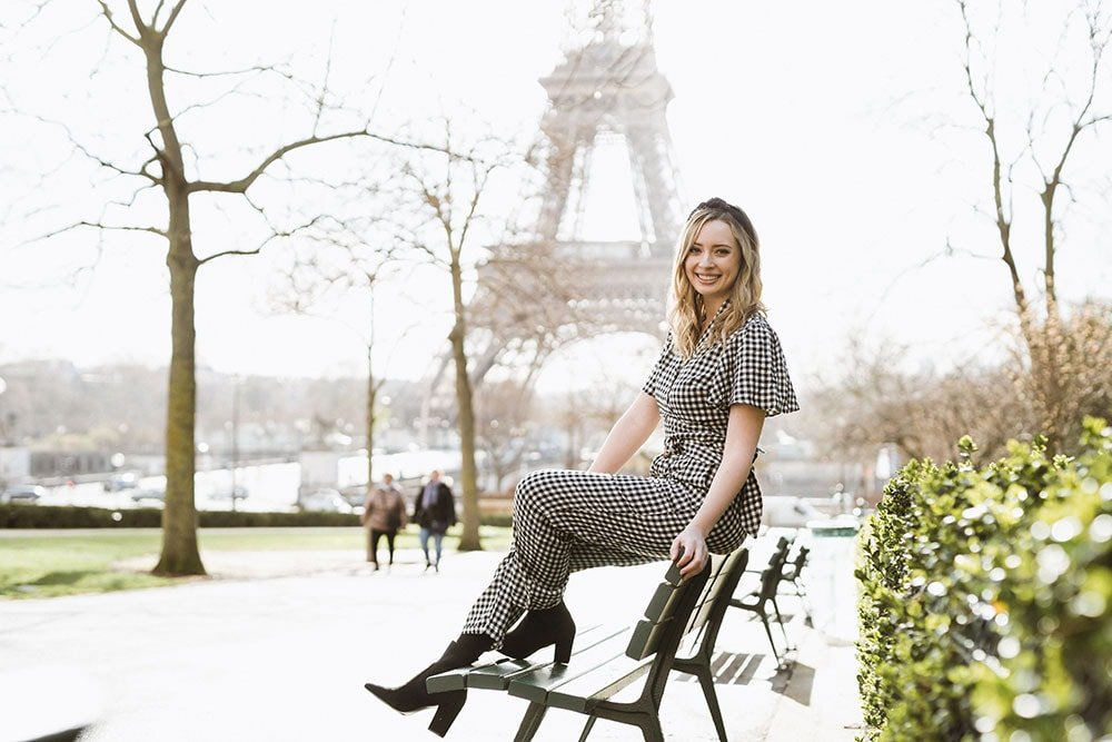 Sitting on a bench with the eiffel tower in the background