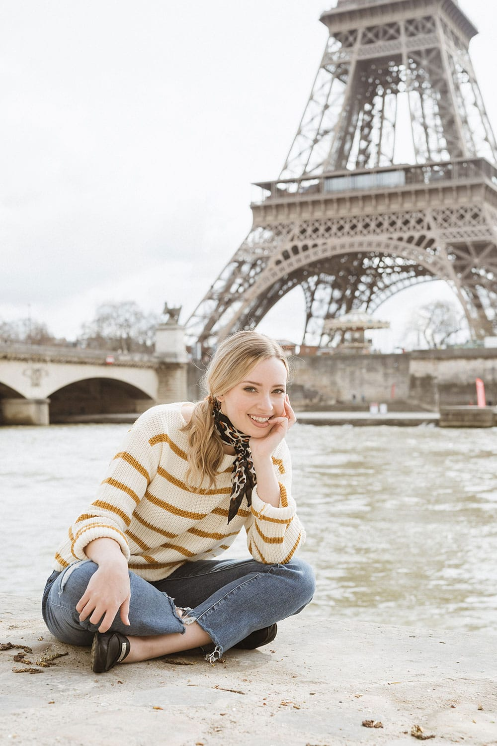 Sitting in front of the River Seine with the Eiffel Tower in the background