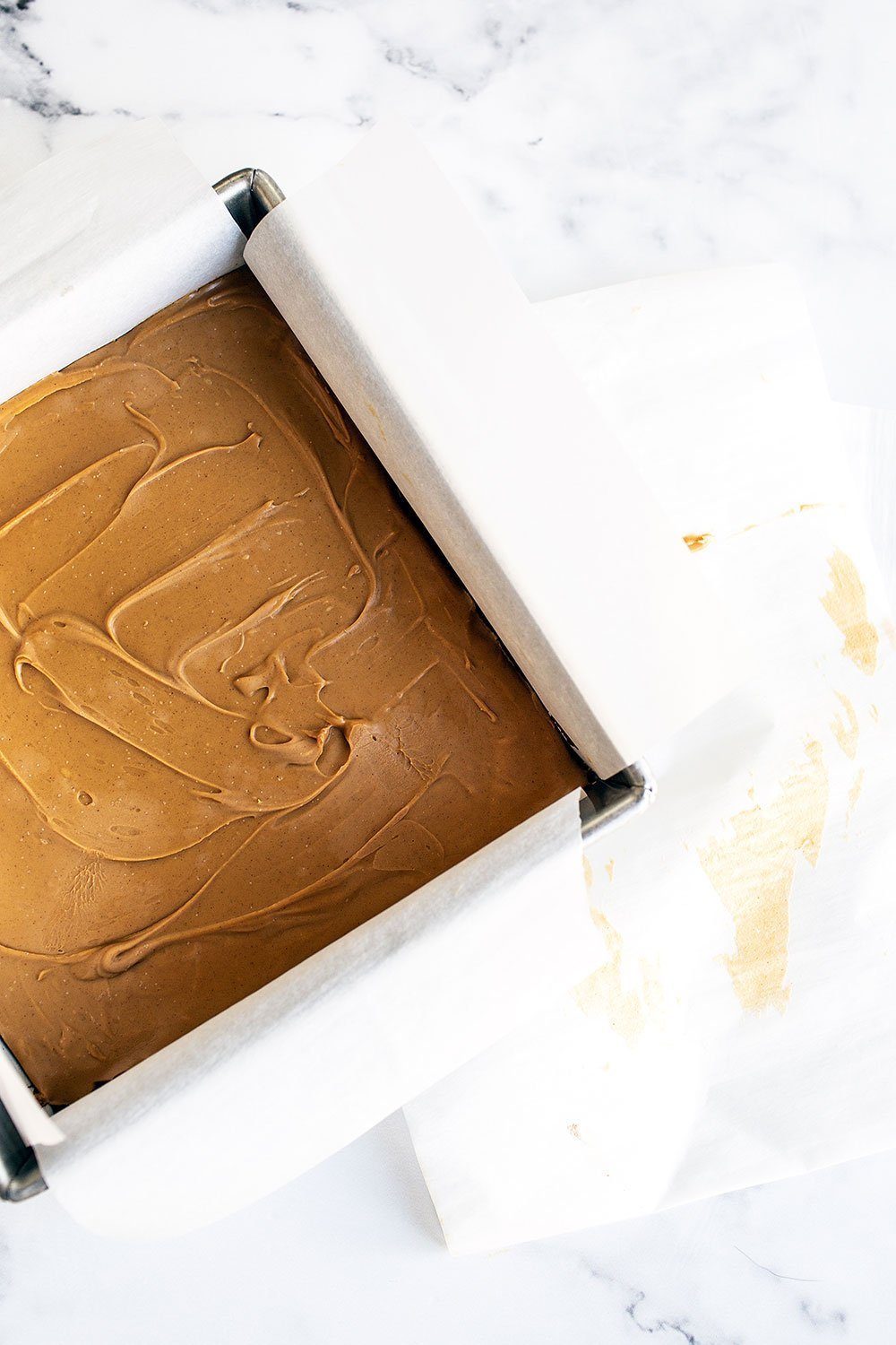 Sheet of frozen peanut butter for filling chocolate brownies