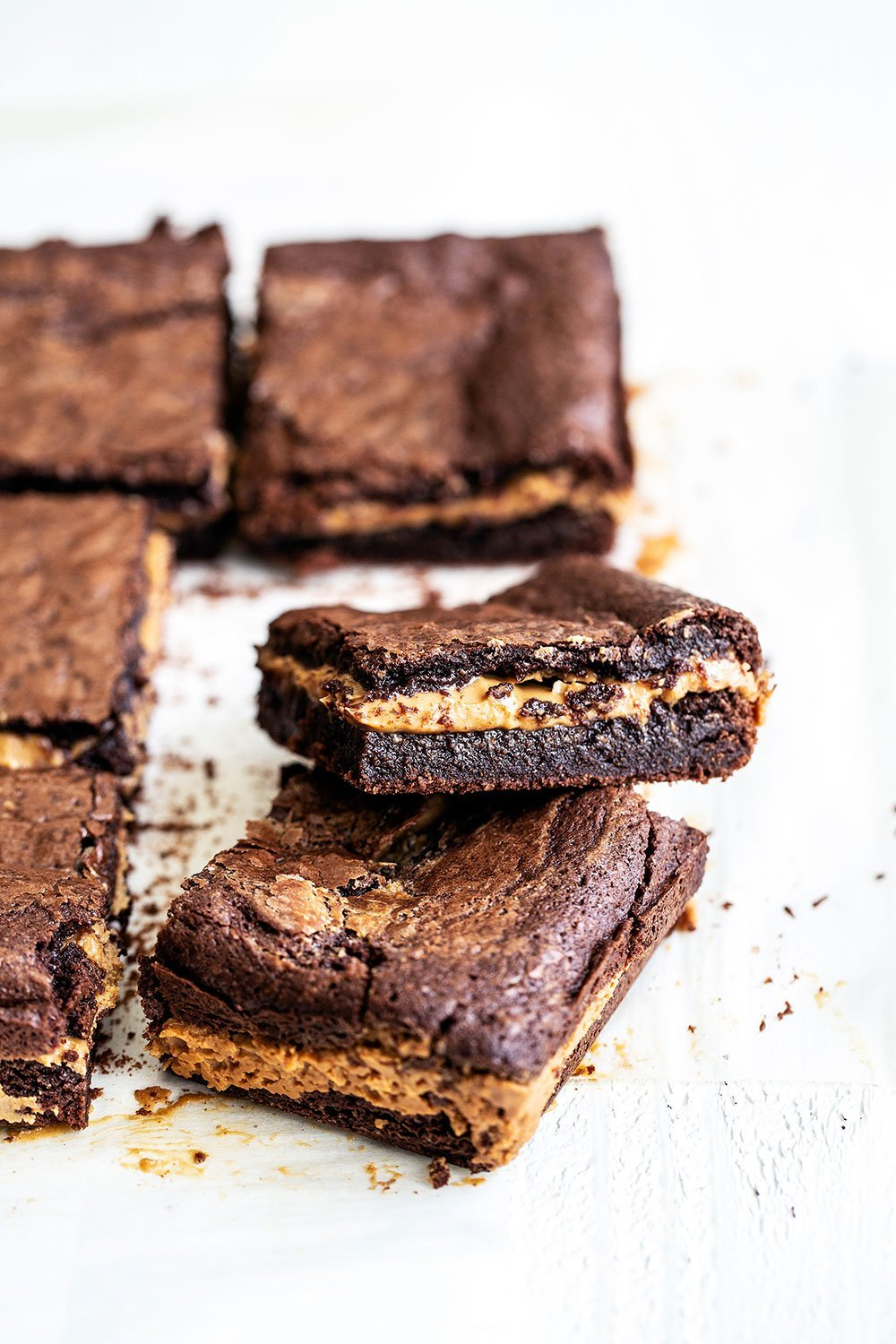 Easy peanut butter filled chocolate brownies cut into squares and stacked on top of each other
