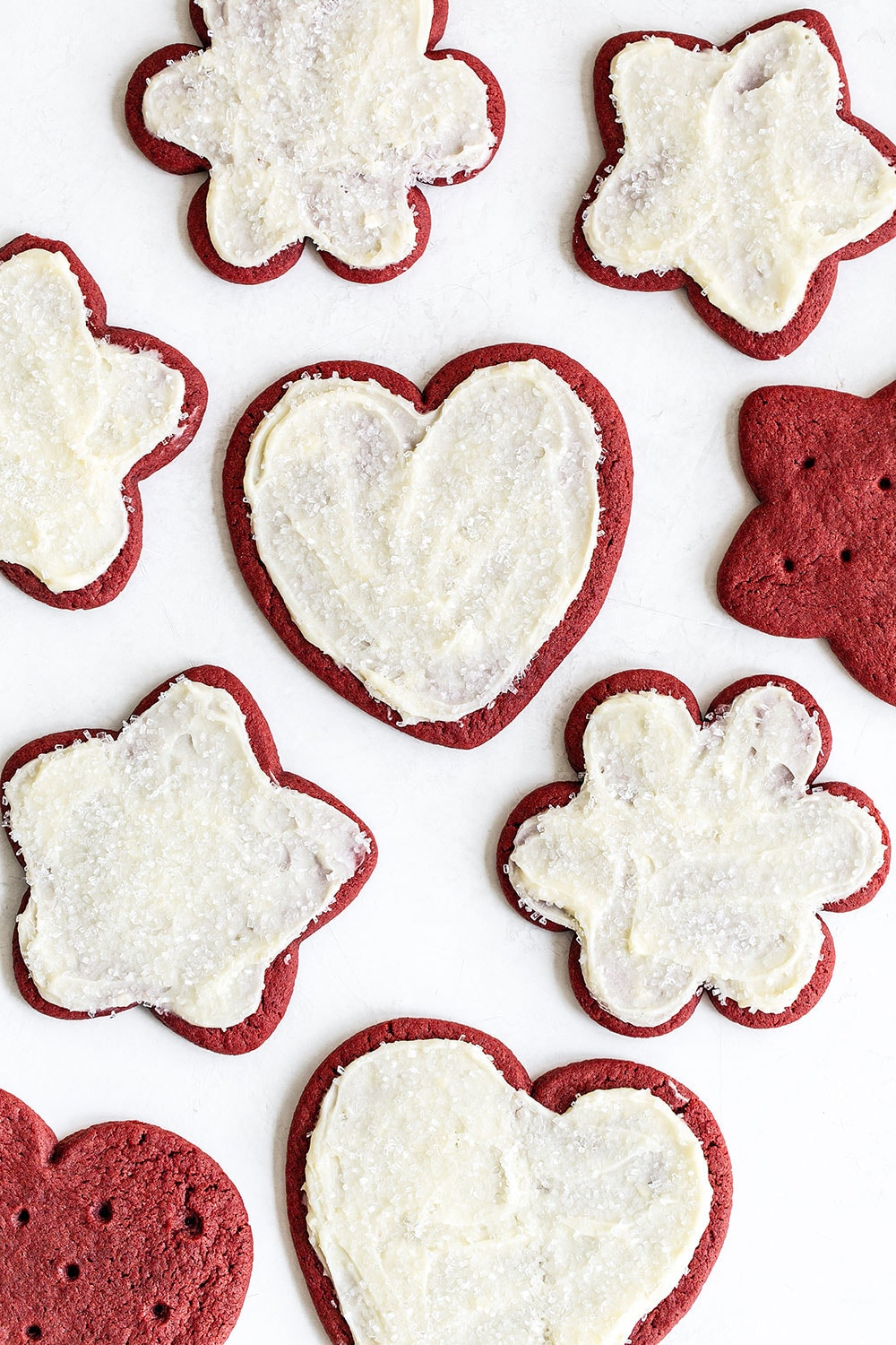 homemade red velvet cut out cookies with cream cheese frosting