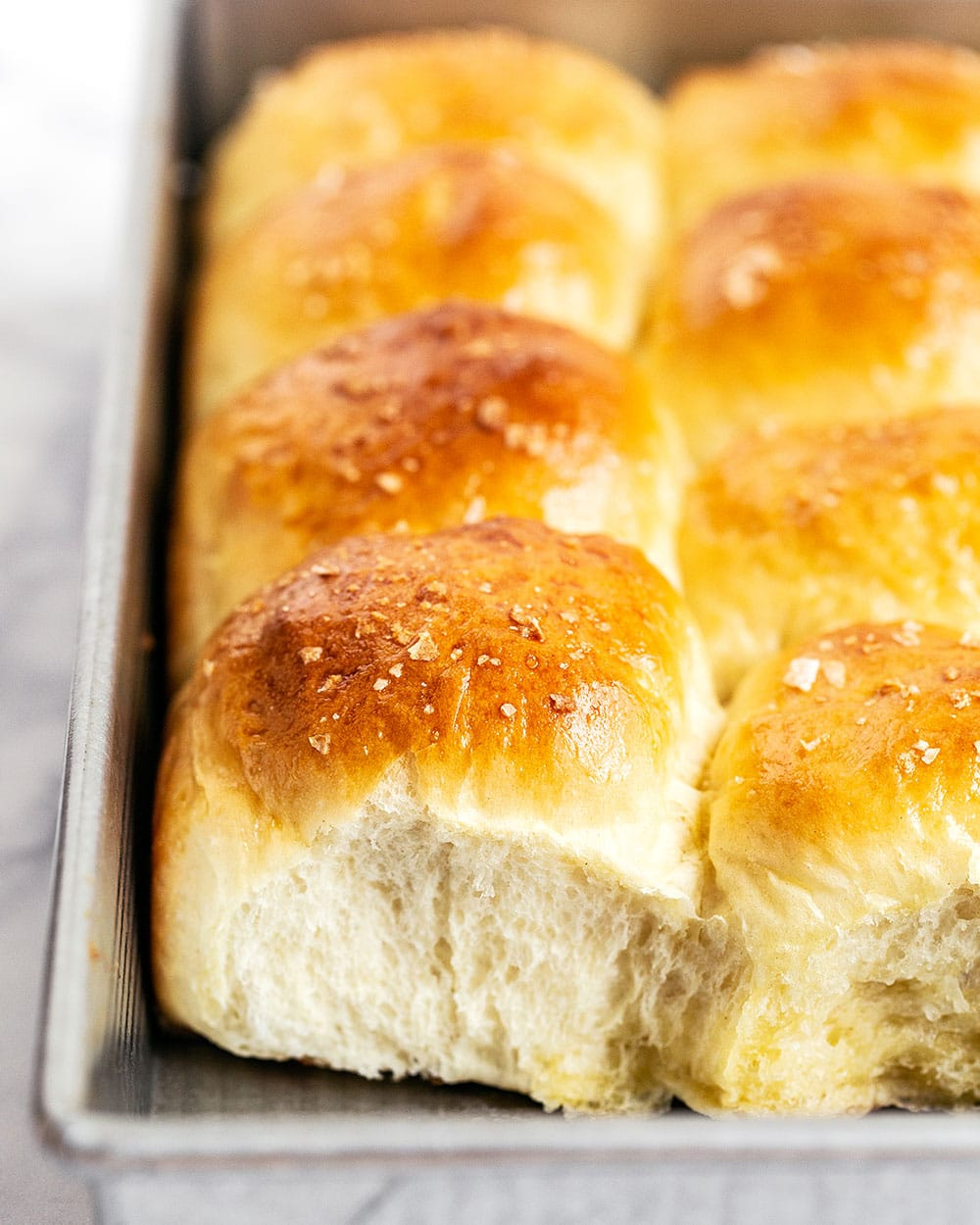 Tray of homemade soft and fluffy bread rolls