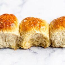 Three soft buttery dinner rolls