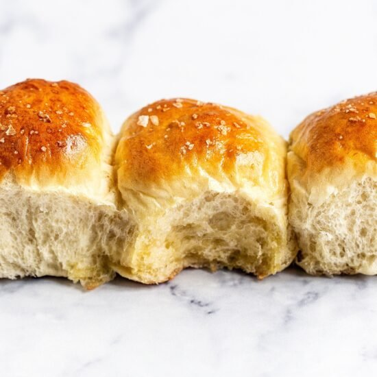 Three soft buttery dinner rolls