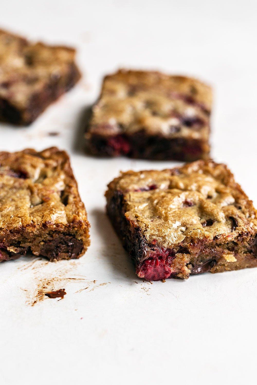 Gooey blondies stuffed with tart raspberries and melty dark chocolate