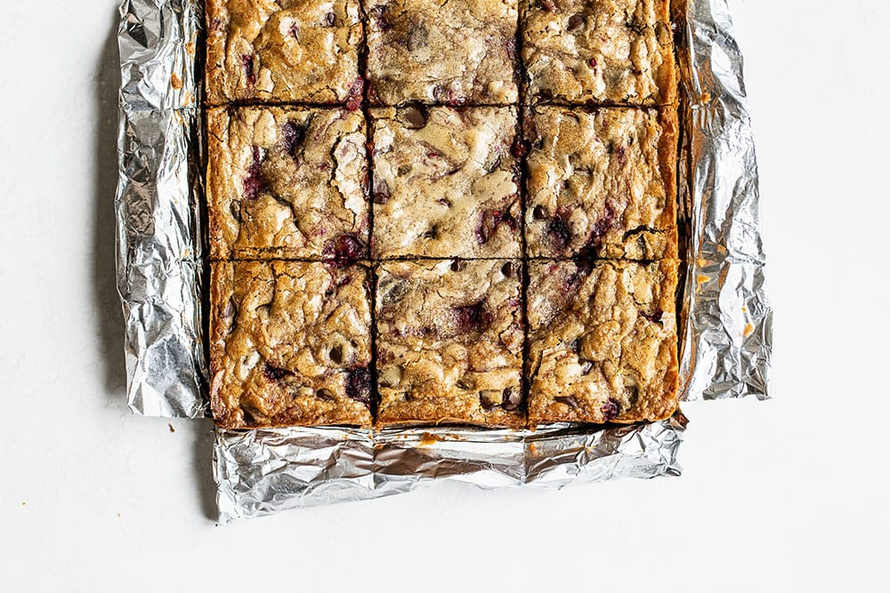 Dark Chocolate and Raspberry Blondies sliced into squares