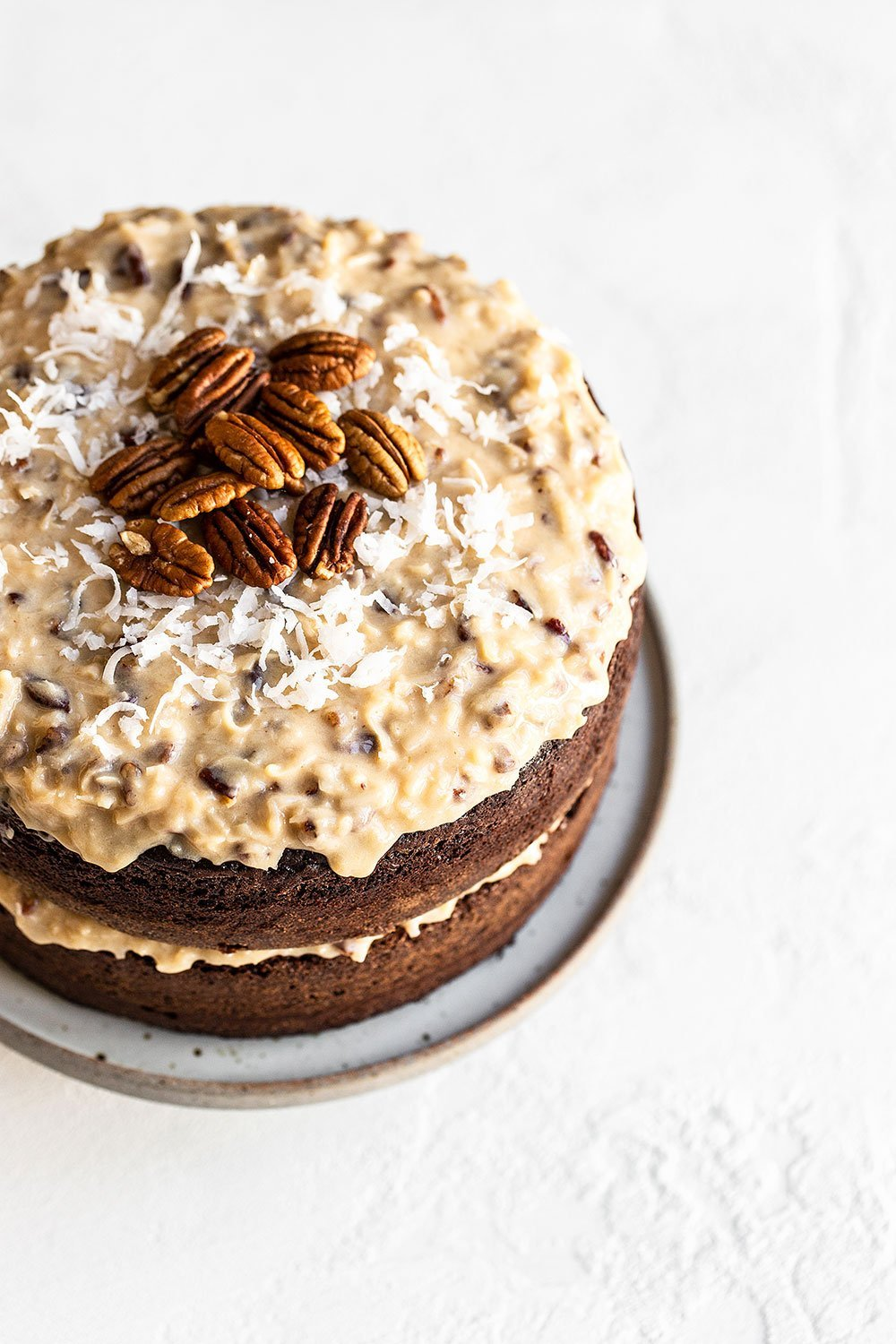 Chocolate Cake with Coconut Pecan Frosting on a plate