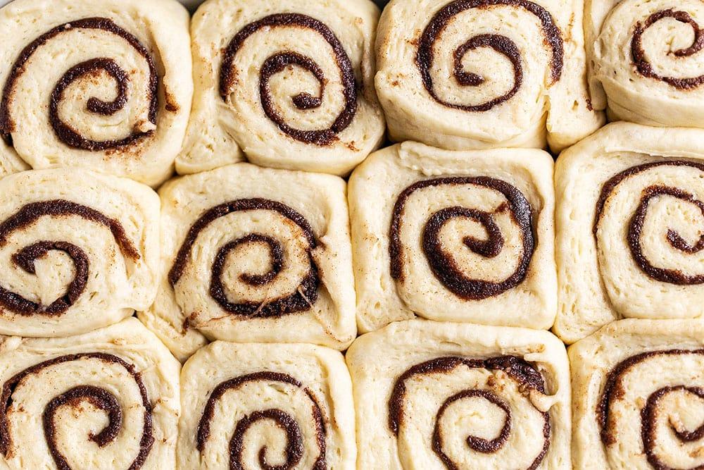 Unbaked cinnamon rolls rising