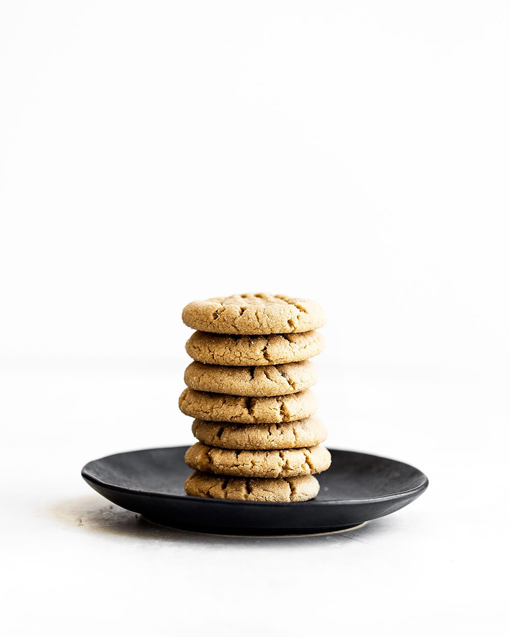 Stack of peanut butter cookies on a plate