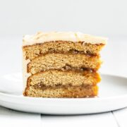 Slice of Butterscotch layer cake with butterscotch sauce filling and buttercream on top