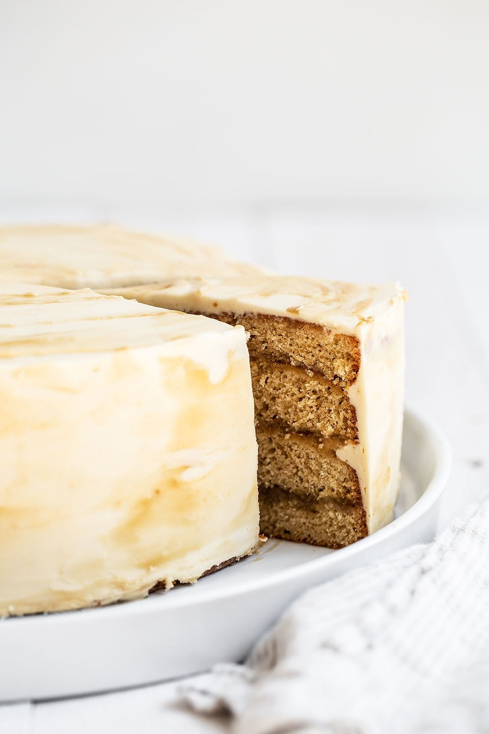 Slice of layer cake being cut out on a platter