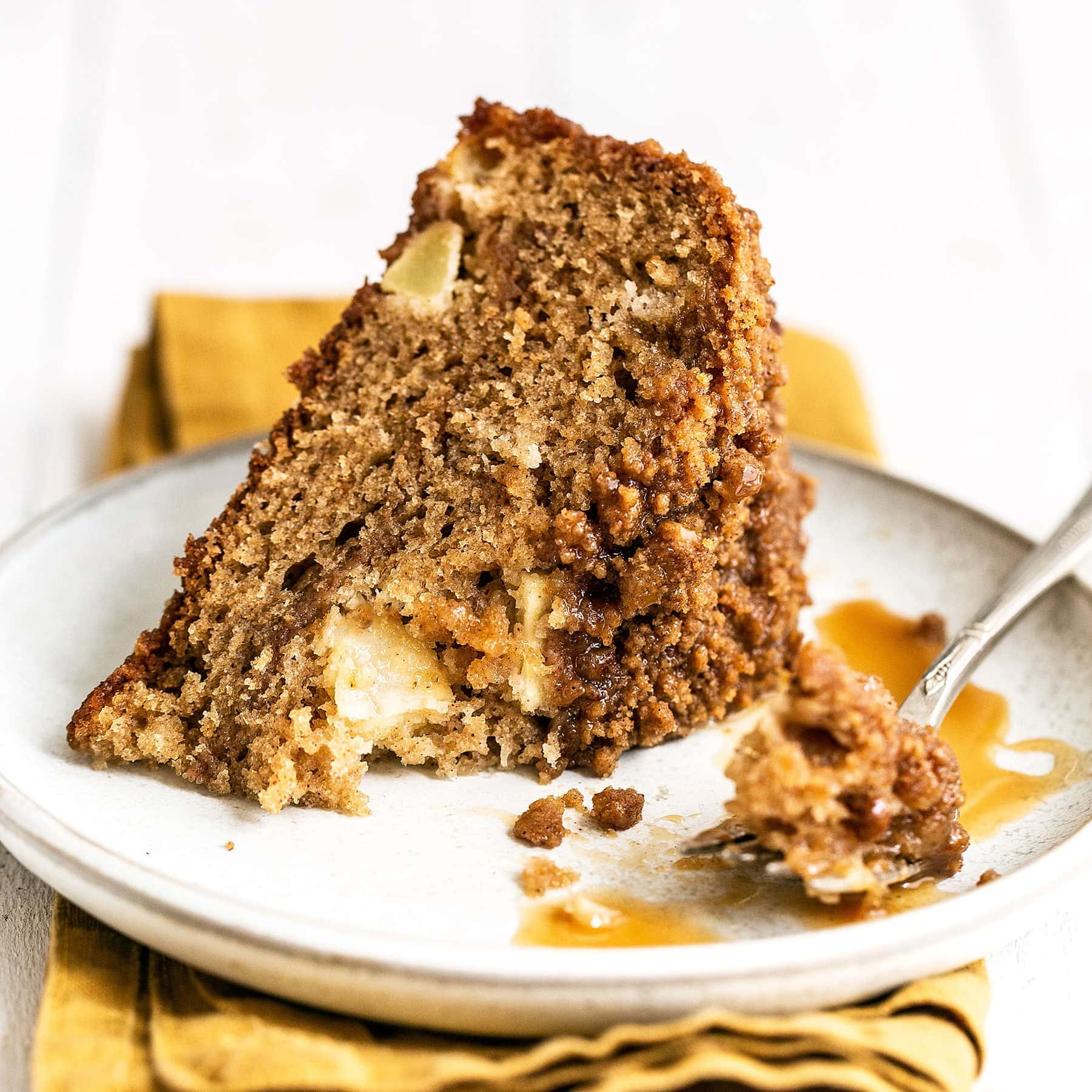 slice of caramel apple coffee cake with a bite taken out