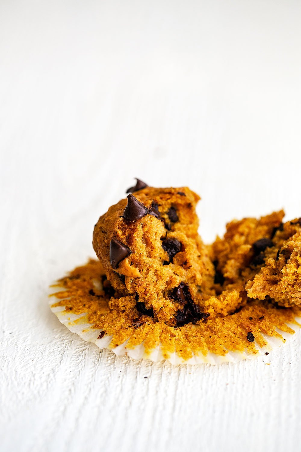 Pumpkin chocolate chip muffin broken apart from eating