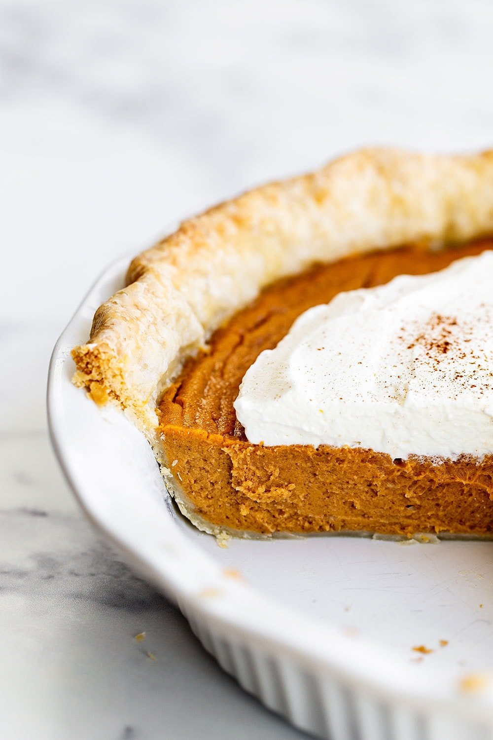 Slice of sweet potato pie taken out of pie dish