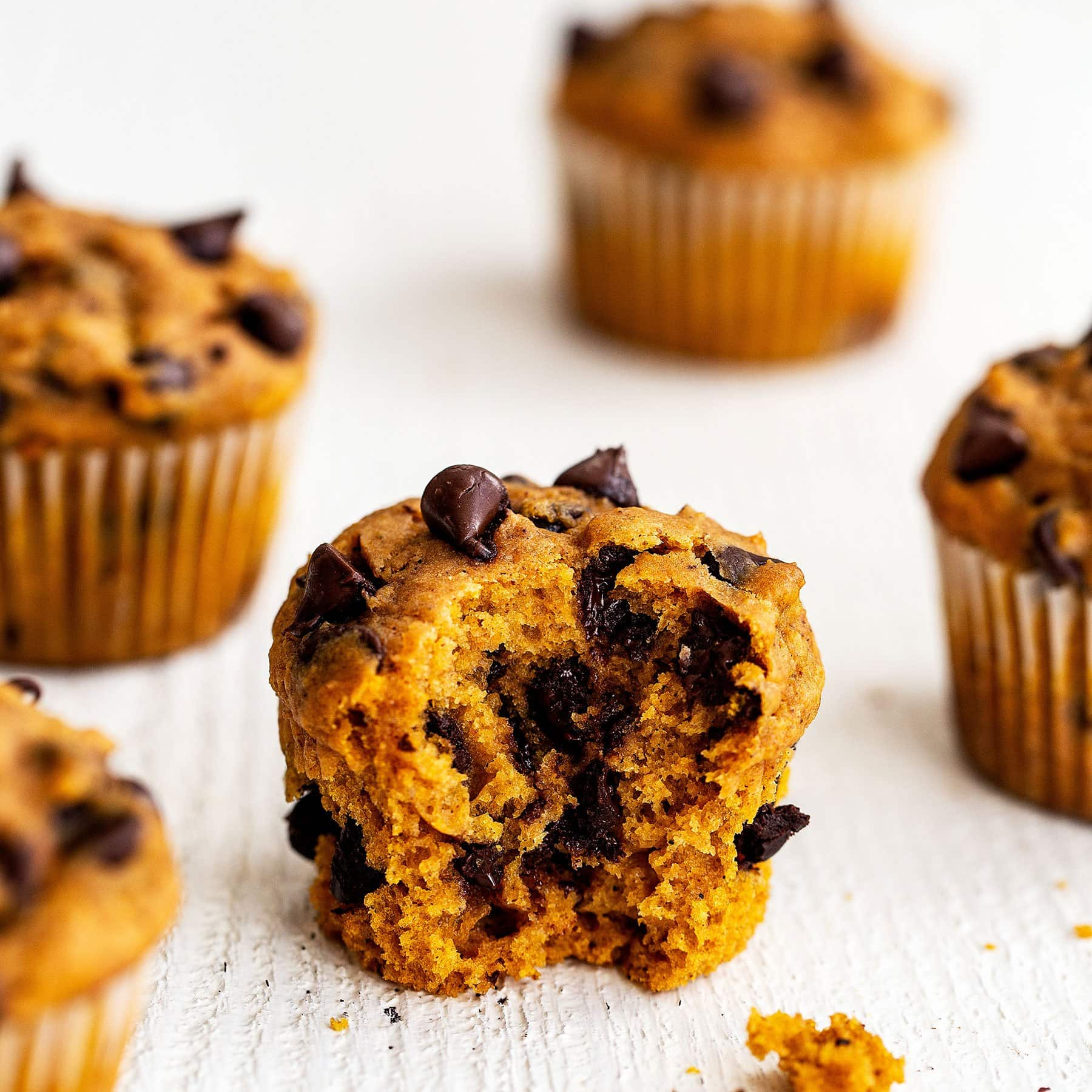 Quick and easy pumpkin chocolate chip muffins with a bite taken out