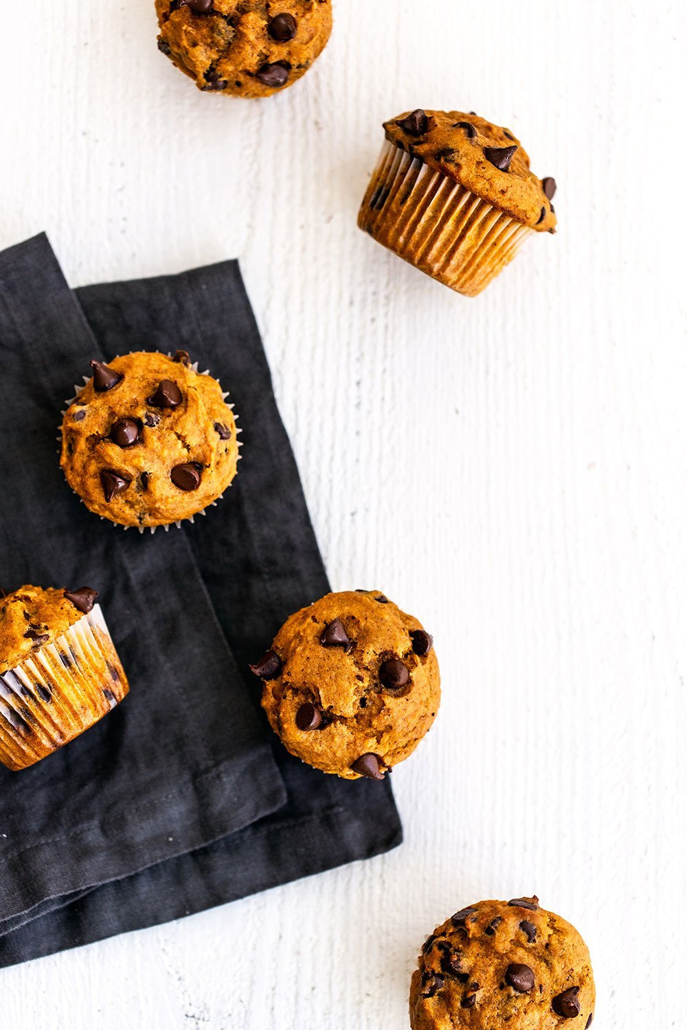 Pumpkin chocolate chip muffins with a napkin