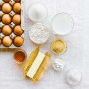 Eggs, butter, flour, sugar, and other baking ingredients on a table