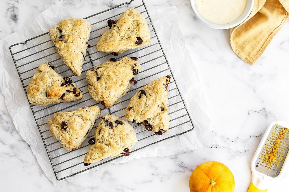 Homemade cranberry orange scones cooling on a rack