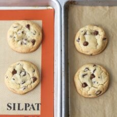 Chocolate chip cookies baked on a Silpat vs parchment paper to compare the differences