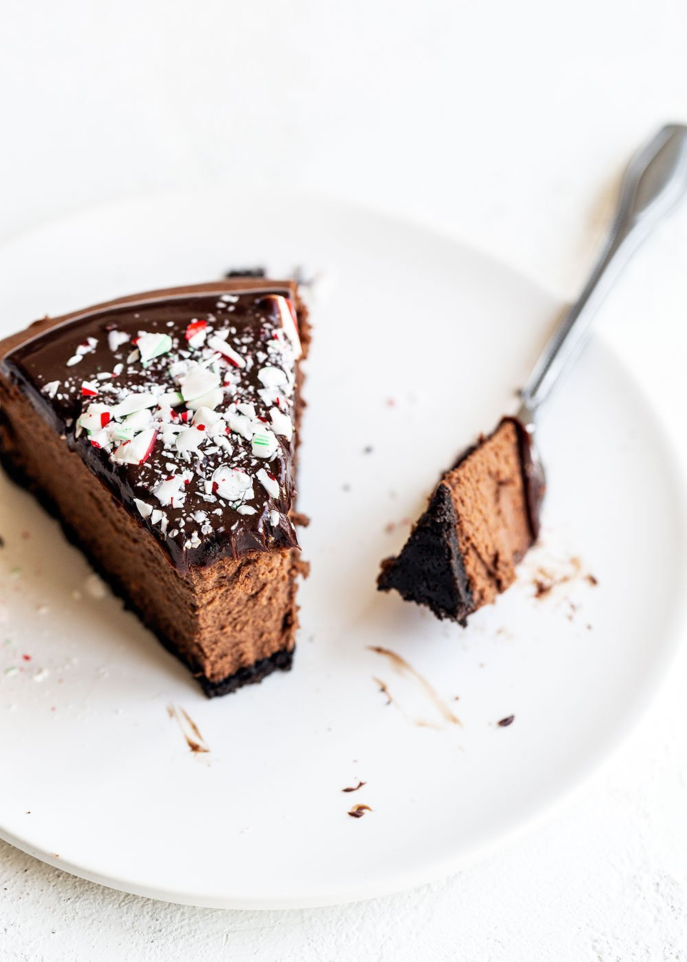 Slice of chocolate peppermint cheesecake with a bite removed