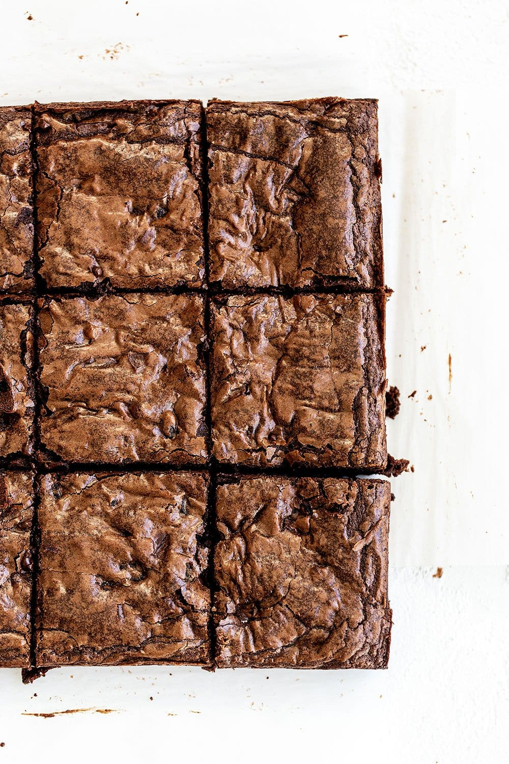 Brownies cut into squares with crinkly glossy tops