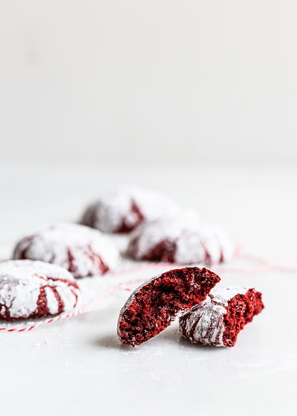Red Velvet Crinkle cookie broken up to reveal soft interior