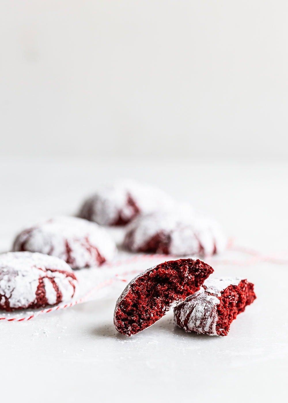 Red Velvet Crinkle cookie broken up to reveal soft interior