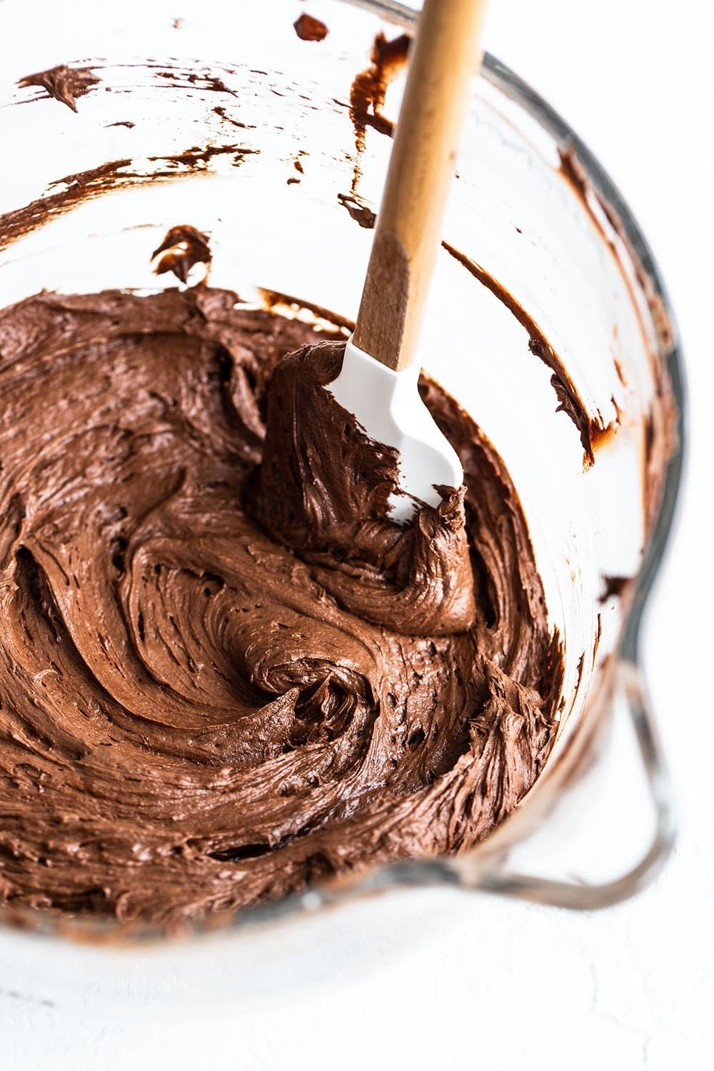 Mixing bowl with smooth chocolate buttercream frosting