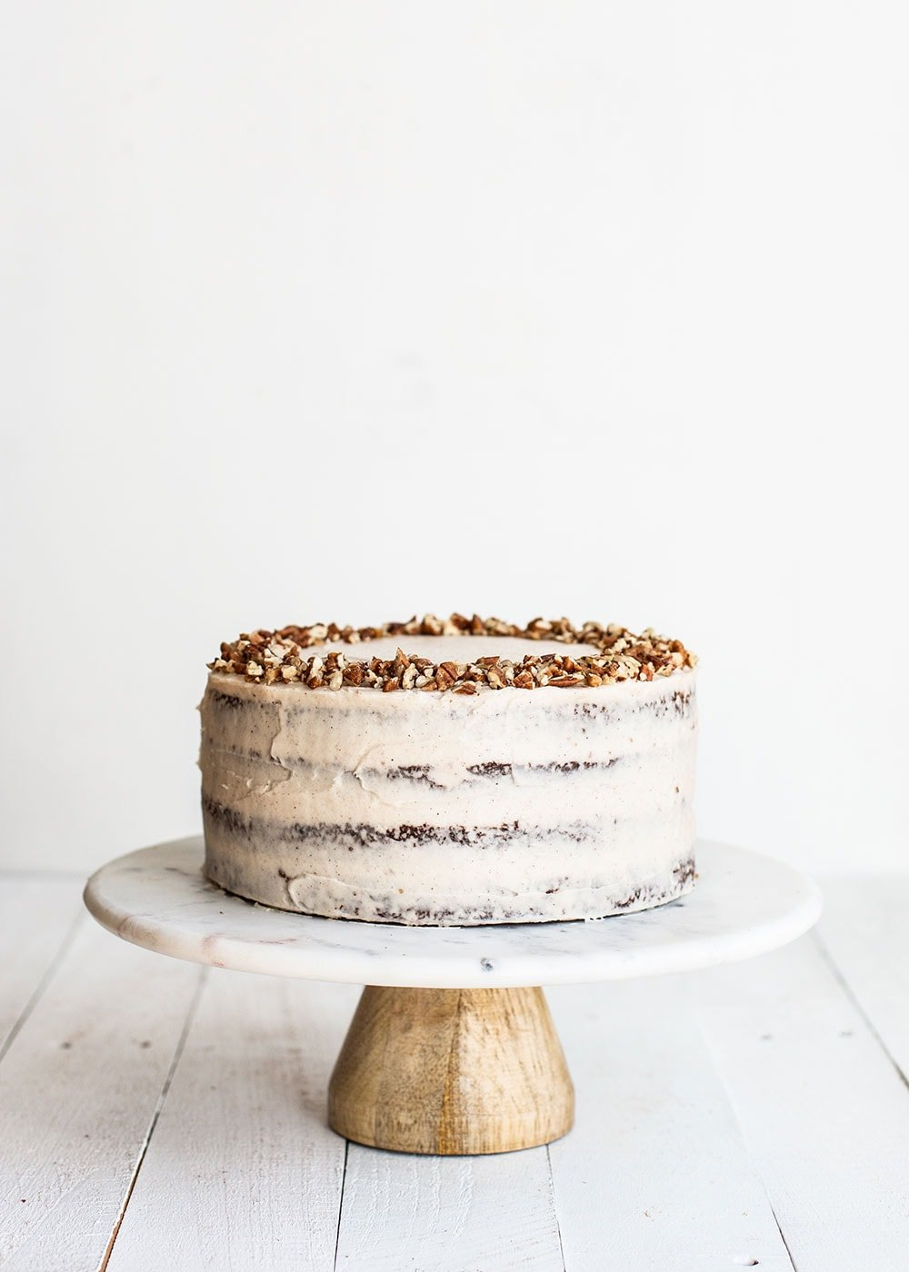 Four layer brown butter carrot cake on a cake stand