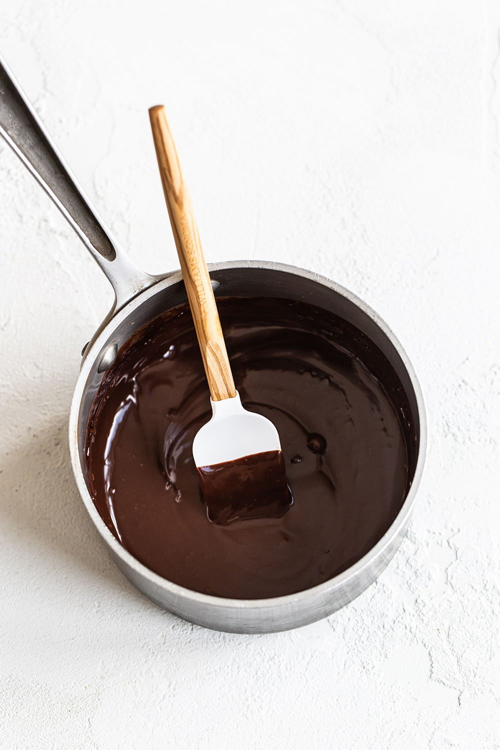 Chocolate ganache in a saucepan