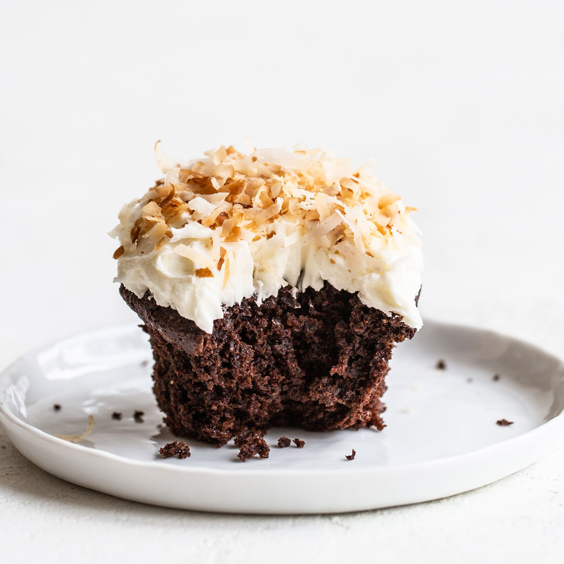 Easter Chocolate Coconut Cupcake on a plate with a bite taken out
