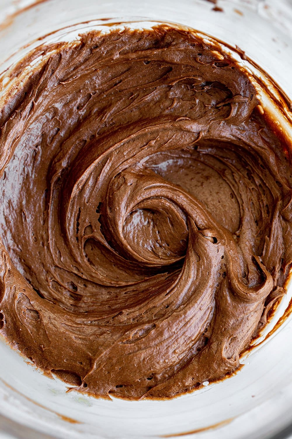thick and rich brownie batter in a mixing bowl