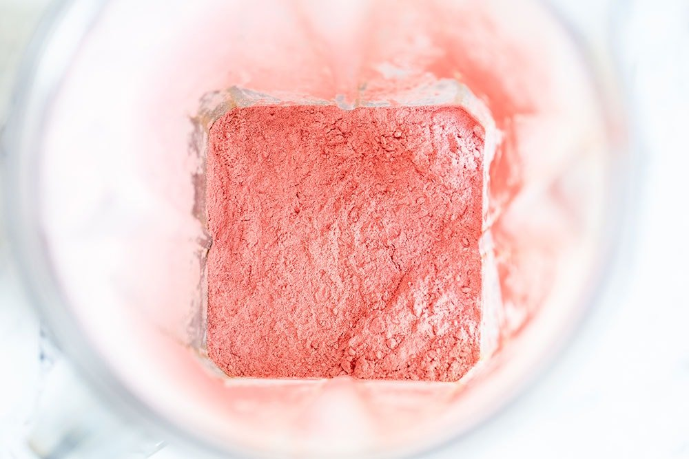 Freeze dried strawberries pulverized into a powder in the blender
