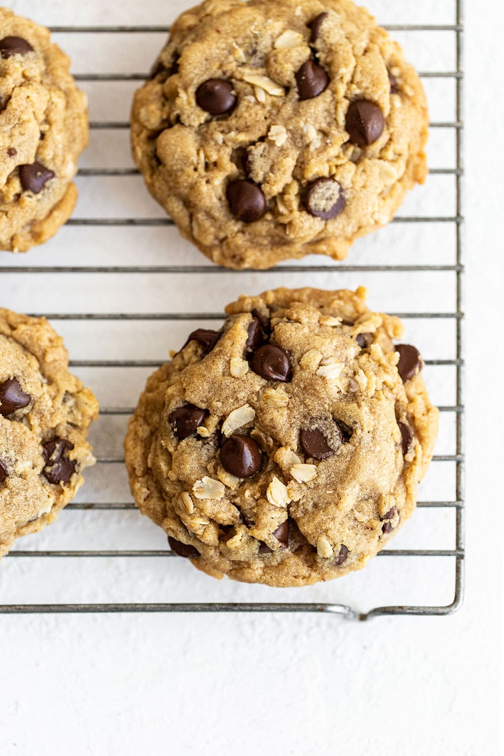 soft peanut butter oatmeal chocolate chip cookies on a cooling rack