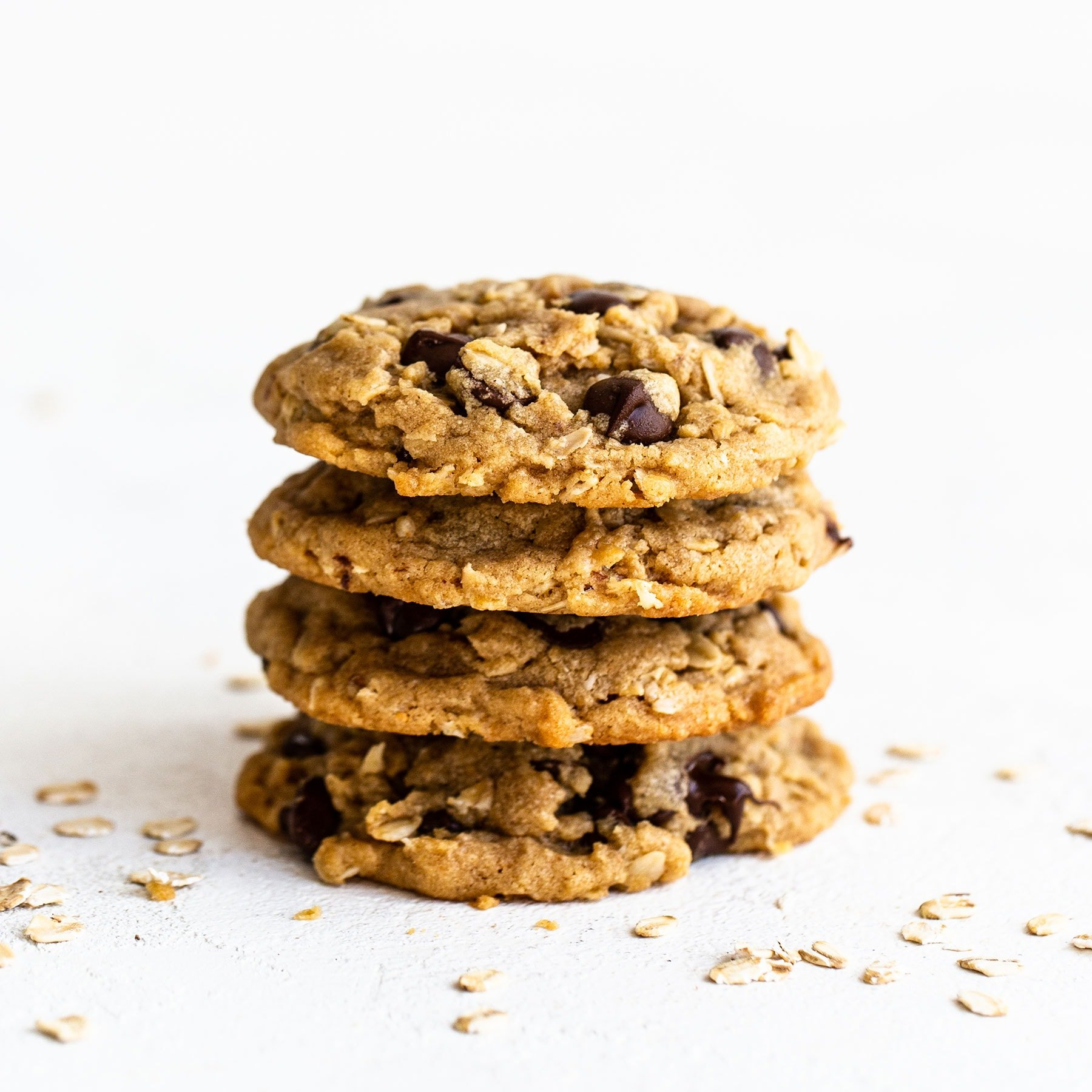 Stack of four peanut butter oatmeal chocolate chip cookies