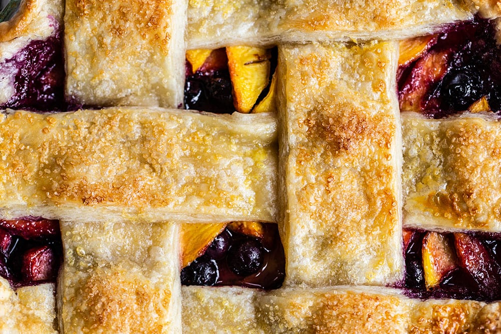 Up close look at the baked lattice top of the blueberry peach pie