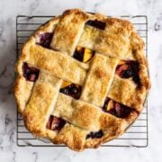 freshly baked blueberry peach pie cooling on rack