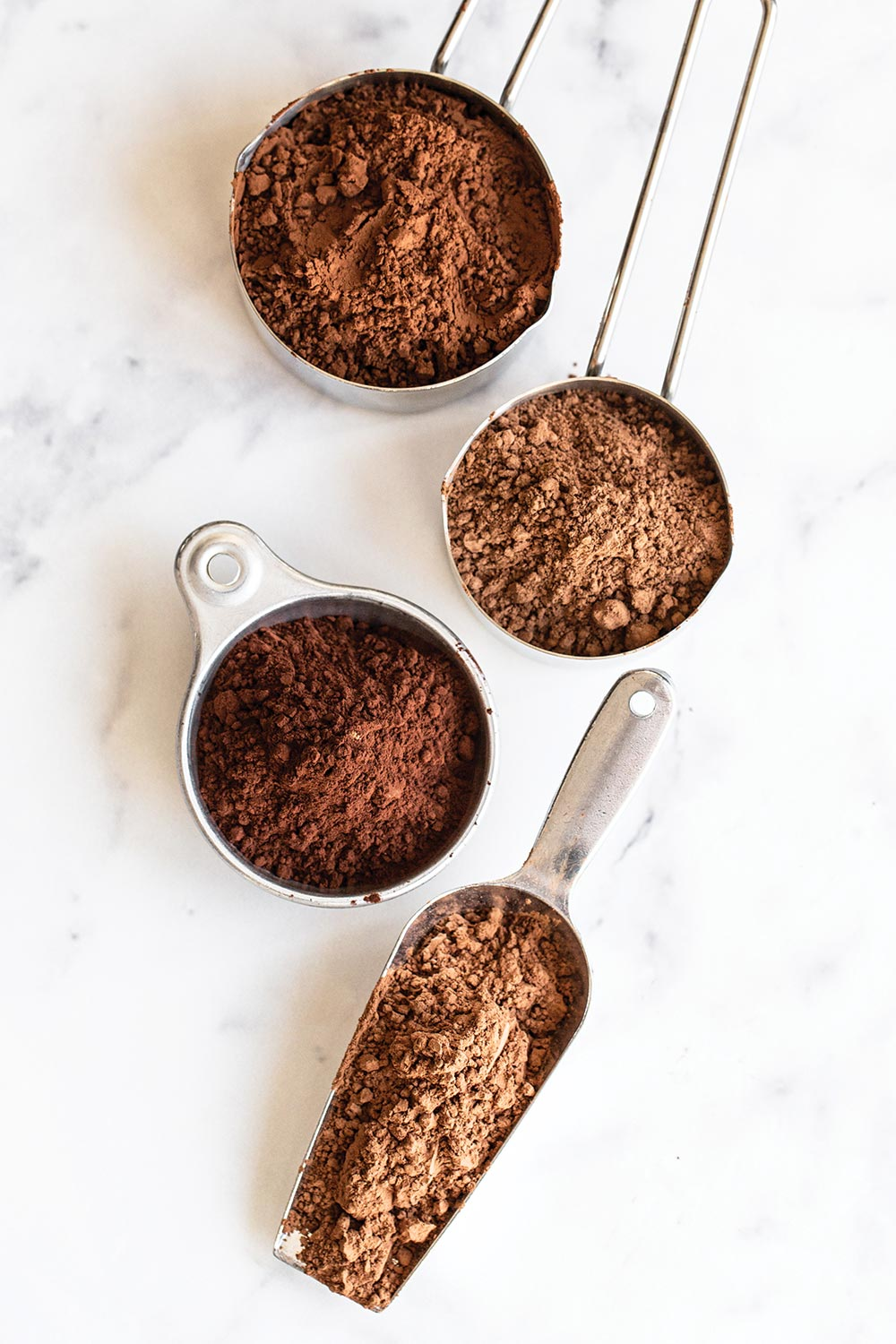 cocoa powder and dutch processed cocoa powder in measuring cups