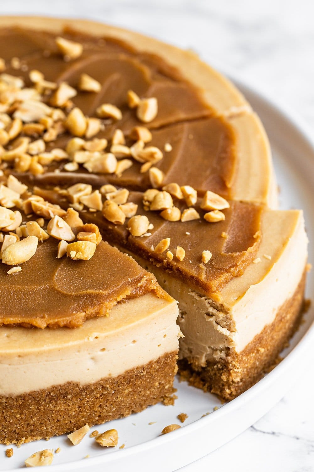 slice being served of ultimate peanut butter cheesecake recipe