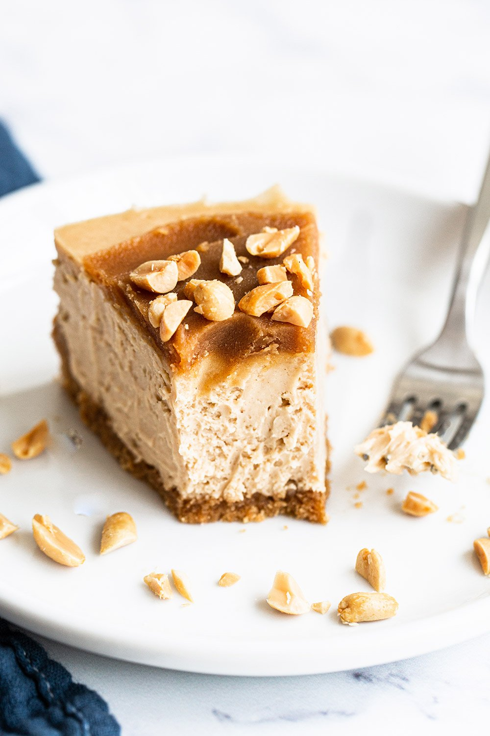 bite taken out of ultimate peanut butter cheesecake recipe