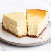 cheesecakes on a plate that have been baked with and without water baths